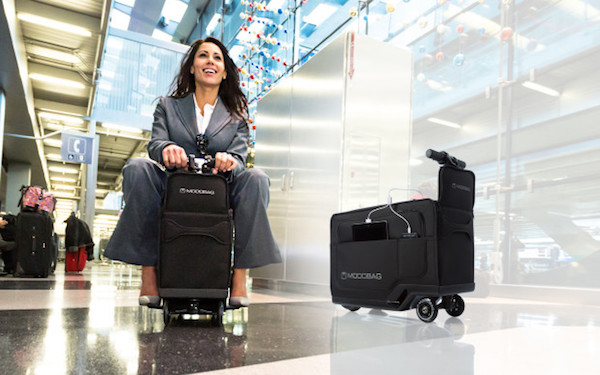 now-travelers-can-ride-through-the-airport-on-their-luggage-with-the-motorized-modobag