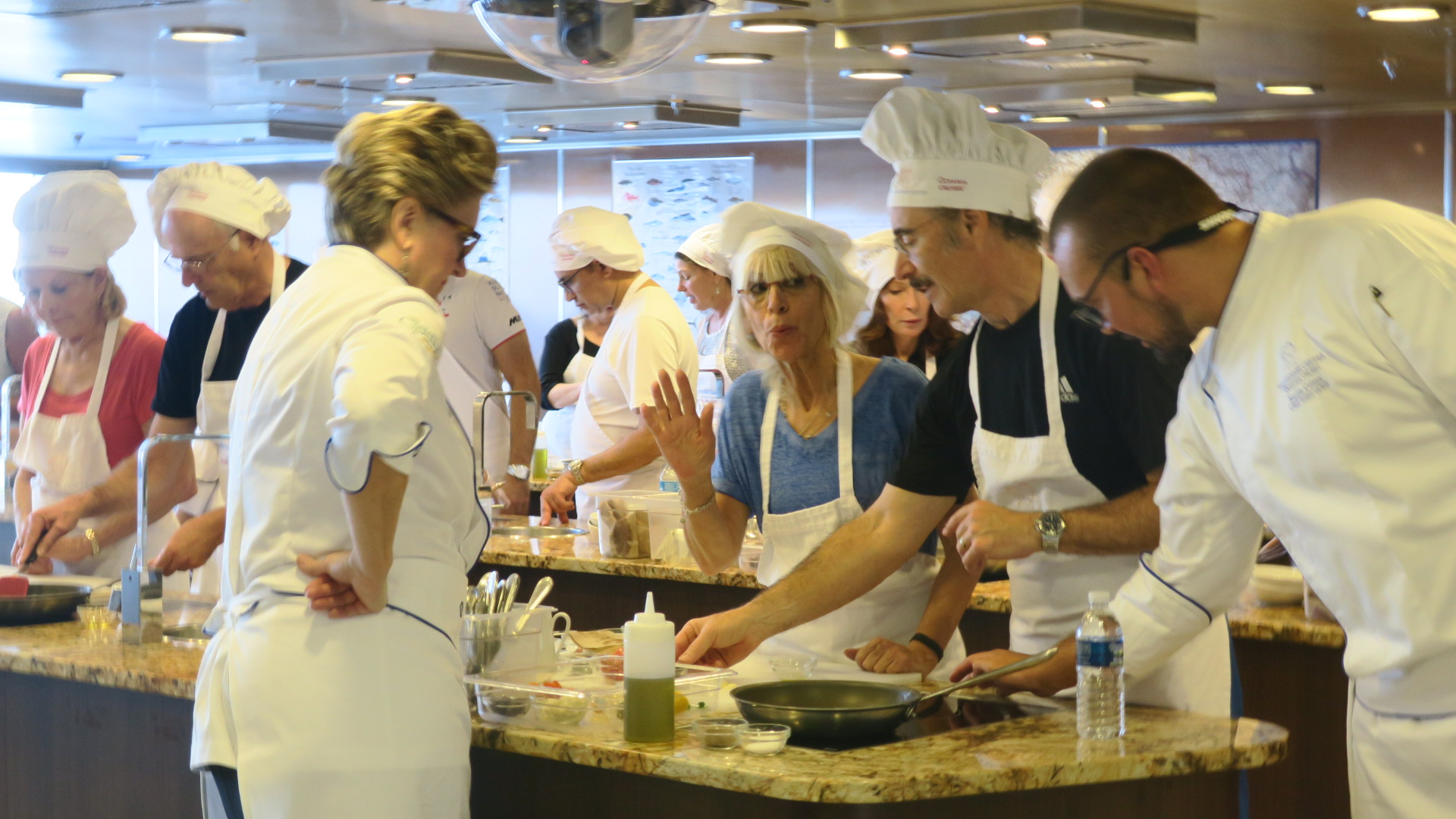 Oceania's Director of Culinary Enrichment Kathryn Kelly and Master Chef Karlis teach a class
