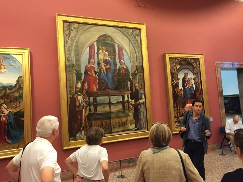 An art historian with A Private View of Italy leads a tour.