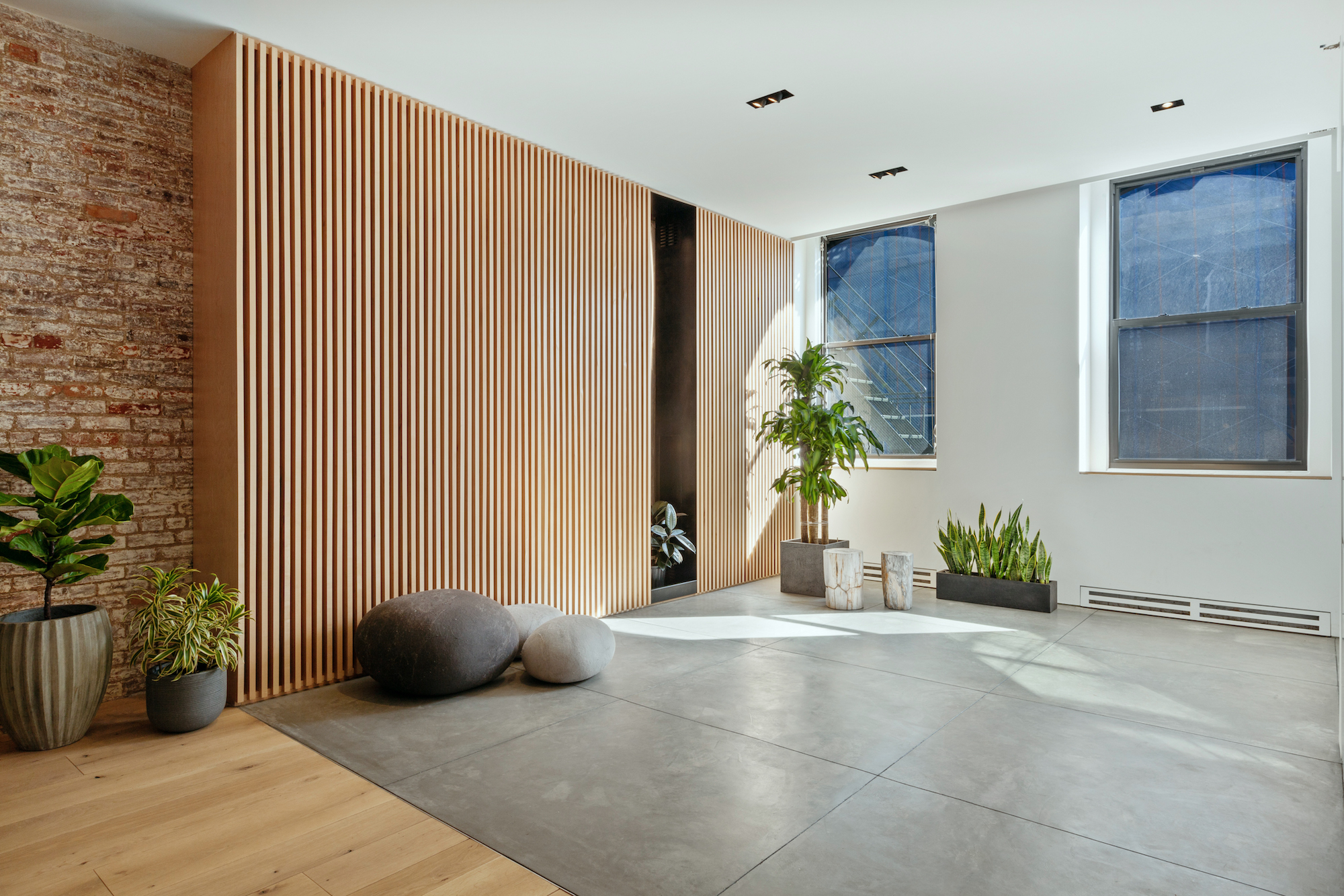 The Unit Has A Concrete Floored Foyer That Flows Into