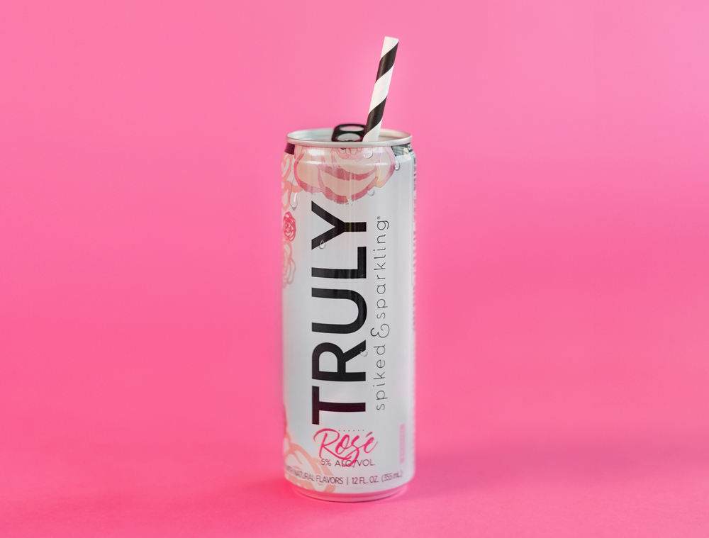 Truly Spiked & Sparkling's Newest Flavor Tastes Like Rosé  and It's All We're Drinking the Rest of Summer