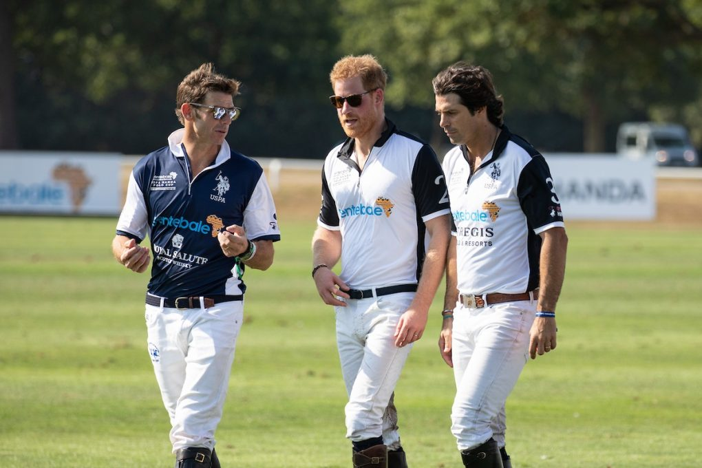 Malcolm Borwick (left), Prince Harry and Nacho Figueras (right) discuss the polo match.