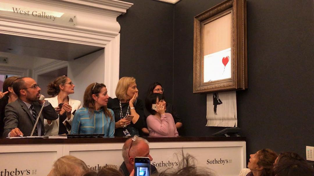 Banksy Painting Self-Destructs Moments After Being Sold For $1.4 Million At Auction